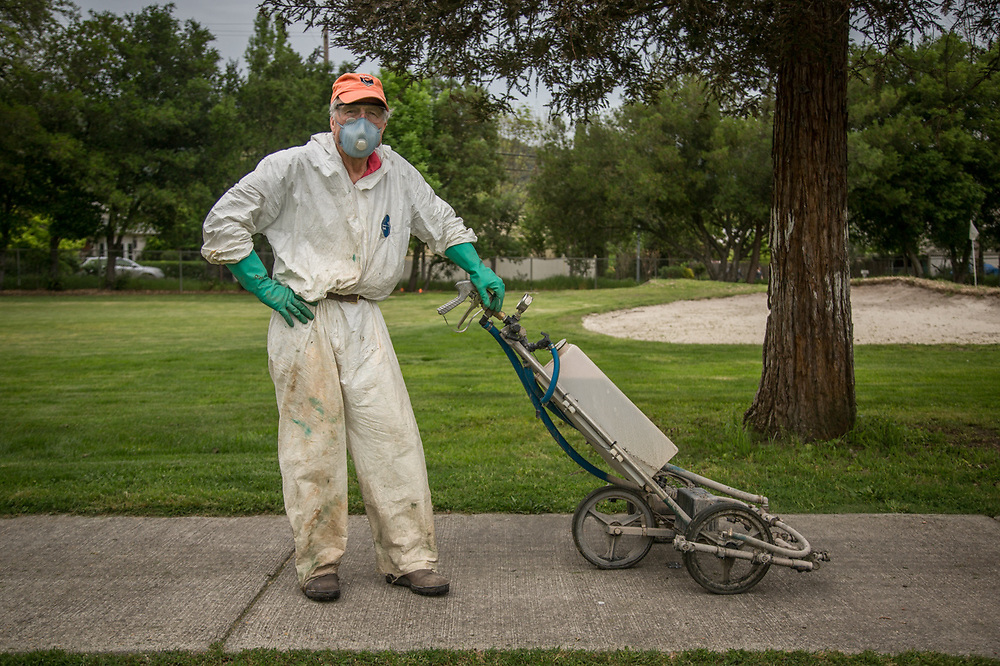 "Volunteer Dick Engelhard prepares to spray the greens at the Calistoga Golf Course.  ""This is perfect...no one will ever recognize me."""