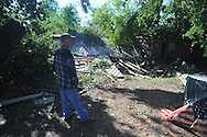 Tim Jones looks at storm damage at J.D. Jones house in the Pine Flat area of Lafayette County south of Oxford, Miss. on Thursday, April 28, 2011. A Wednesday afternoon storm destroyed houses and uprooted trees.