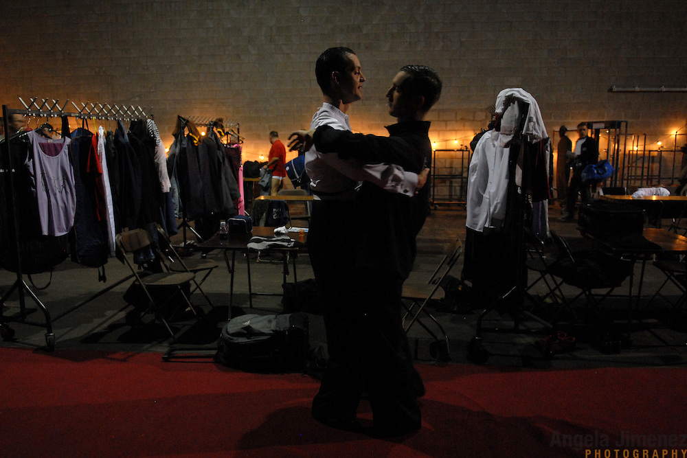 Csaba Csetneki, left, and Ga'ti Bala'zs, both of Hungary, warm up in the coed dressing area before competing in the adult men's standard division of the same-sex ballroom dancing competition during the 2007 Eurogames at the Waagnatie hangar in Antwerp, Belgium on July 13, 2007. ..Over 3,000 LGBT athletes competed in 11 sports, including same-sex dance, during the 11th annual European gay sporting event. Same-sex ballroom is a growing sports that has been happening in Europe for over two decades.