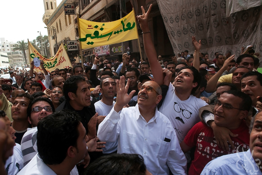 Egyptian Nobel Peace laureate and former UN atomic watchdog chief, Mohamed ElBaradei (C), waves to supporters on balconies above as he leaves Friday noon prayers in the Egyptian delta town of El Mansoura on April 2, 2010. ElBaradei is thought to be a possible candidate to run against Egyptian President Hosni Mubarak in the 2011 presidential election, although he has not made a formal declaration as of yet.
