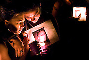 Latanya Thomas, left, and Jessenia Cardenas bow their heads during a candlelight vigil for their friend, Tiairra Garcia, Sunday at Volunteer Park in Pasco. Around 100 attended the vigil for Garcia, who has been missing since June 22. Her mother, Donna, is organizing a search for her daughter Monday. Interested volunteers should meet at the Metro Mart at 10th Avenue and Lewis Street at 6 a.m. Garcia says to come with a full tank of gas and long pants for the search at an undisclosed location out of town.