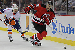 Apr 3; Newark, NJ, USA; New Jersey Devils right wing Petr Sykora (15) skates with the puck while being chased by New York Islanders center Marty Reasoner (16) during the second period at the Prudential Center.