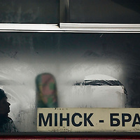 A passenger on the Minsk-to-Bragin bus waits at a station for the continuation of the journey on April 5, 2006. Transportation by bus and train, although reliable and regular, is extremely slow due to deficient  infrastructure and old vehicles.