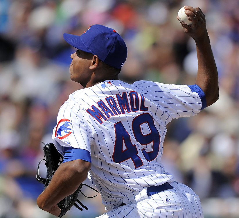 MESA, AZ - MARCH 6:  Carlos Marmol #49 of the Chicago Cubs pitches against the Chicago White Sox on March 6, 2010 at HoHoKam Park in Mesa, Arizona. (Photo by Ron Vesely)
