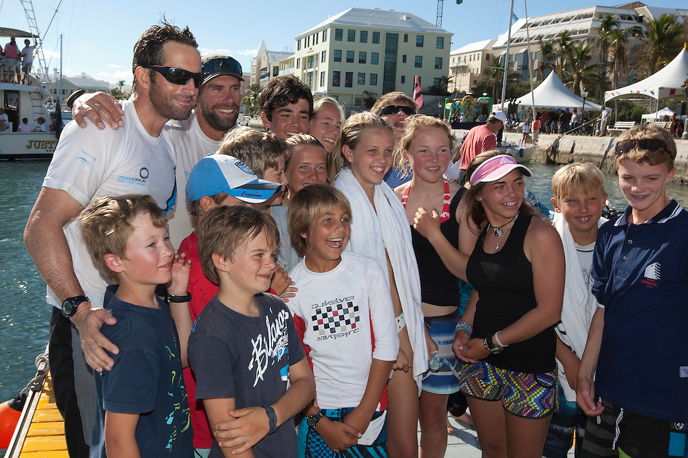 ben Ainslie and Ian Percy pose for photos with Junior Gold Cup sailors after winning during the Argo Group Gold Cup 2010. Hamilton, Bermuda. 10 October 2010. Photo: Subzero Images/WMRT