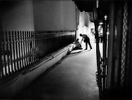Man giving a coin to beggar on Tunis street at night, Tunisia.