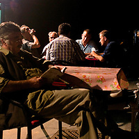 Men sip tea and play games in the evening near the Suleyman mosque in Istanbul.