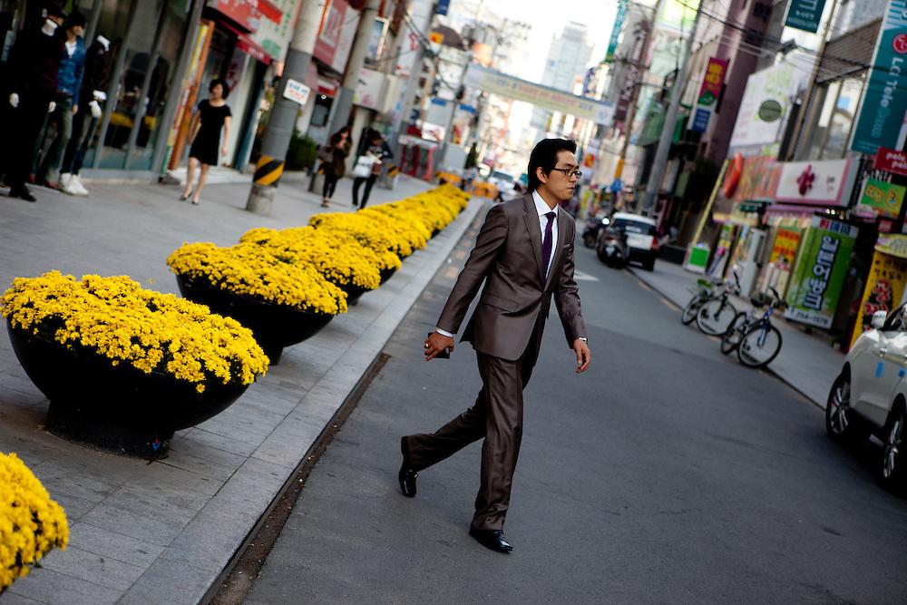 Daegu/South Korea, Republic Korea, KOR, 16.10.2009: Man with a suit passing a street in the center of the South Korean city of Daegu.