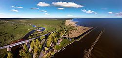 Winding river Emajõgi mouth. Lake Võrtsjärv. Bridge, aerial view.  Road, buildings and pier in Jõesuu.