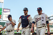 Joe Mauer #7, Kevin Correia #30, and Rick Anderson #40 of the Minnesota Twins head toward the dugout before a game against the Chicago White Sox on June 19, 2013 at Target Field in Minneapolis, Minnesota.  The Twins defeated the White Sox 7 to 4.  Photo: Ben Krause