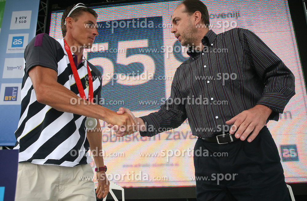 Vasilij Zbogar and Gabrijel Skof, General manager of AdriaticSlovenica at welcome ceremony in Olympic City BTC, on August 23, 2008, in Alea Mladih, BTC, Ljubljana, Slovenia. (Photo by Vid Ponikvar / Sportal Images)./ Sportida)