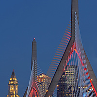 Boston skyline photography from New England and Boston based fine art photographer Juergen Roth showing historic and modern architecture landmarks such as the Custom House of Boston, Leonard P. Zakim Bunker Hill Memorial Bridge, One International Place and the TD Bank North Garden home to the Boston Bruins and Celtics captured on a beautiful twilight night. <br />