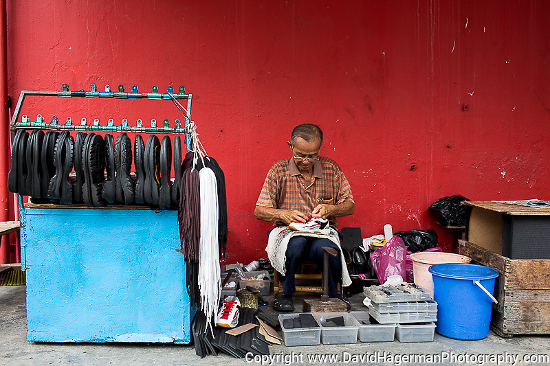 shoe repairman in the 5 ft way at the corner of Pintal Tali and jalan Dr. Lim Chwee Leong