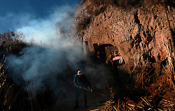 A picture made available on 06 November 2012 of 87-year-old farmer Chao burning firewood outside his cave home or 'yaodong' in the rural outskirts of Yan'an city, Shaanxi Province China, 05 November 2012. The 'yadong' or cave dwellings are typical in the plateaus of northern China in Shaanxi Province where many of Yan'an's rural population still live in. They are mostly carved out from the yellow earth of the Loess hillsides and are about seven to eight metres deep with height and width of three metres. Former Communist leader Mao Zedong and his comrades are known to have hid in these cave homes during the civil war between the communists and nationalists in 1936 to 1948 as they battle the Kuomintang forces. Chao has lived in his cave home in the Loess mountains of Yan'an for more than 60 years, mostly in poverty and hardship as a farmer and was one of the few to have lived through the period of turmoil during the civil war. China's new leaders slated to take over during the 18th National Congress beginning on 08 November are likely to face mounting pressures to tackle the country's rising income inequalities between urban and rural areas that are often the source of simmering resentment and growing unrests on the grassroot level.