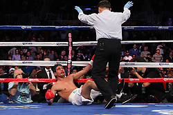 Oct 19, 2012; Brooklyn, NY, USA; Erik Morales is knocked down by WBC/WBA super lightweight champion Danny Garcia during their 12 round bout at the Barclays Center. Garcia won via 4th round KO.