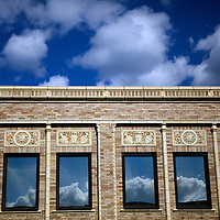 Clouds reflected in a building in downtown Rhinelander, Wisconsin.
