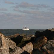 Shrimp boat framed by rocky beach near Jekyll Island