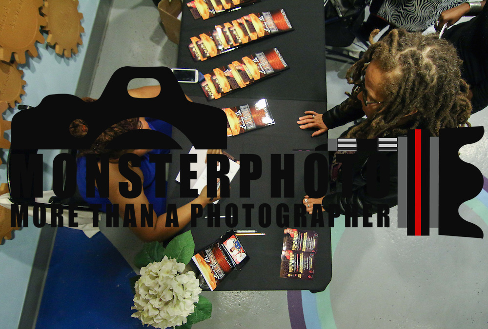 Suite Franchon signs copies of her new book Living the Journey Thursday, Oct. 29, 2015 at the Delaware Children's Museum in Wilmington.