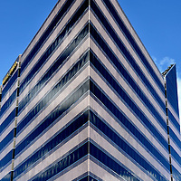 Triangular, Postmodern Glass Building of Wells Fargo Center in Boise, Idaho<br /> Wells Fargo in Boise, Idaho, is only the fourth largest building among financial service companies, but it creates the most exciting visual statement.  Built in 1988 and standing 182 feet, it forms a glass triangle that&rsquo;s accented with horizontal strips.  Together with its use of marble and decorative columns, it&rsquo;s classified as postmodernism.   Perhaps it also caught my eye because Wells Fargo was my client for over thirty years.