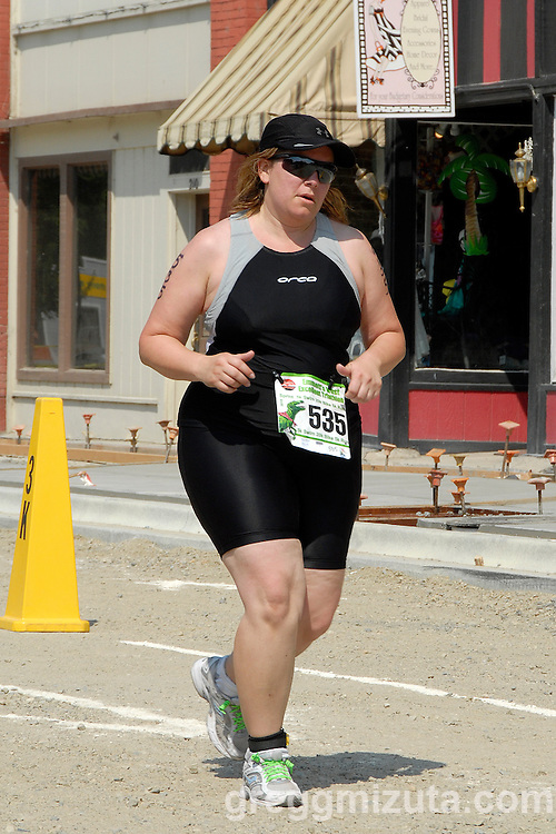 Sarah Barker on Emmet's Main Street during Most Excellent Triathlon on August 7, 2010. <br /> <br /> Barker finished the sprint distance triathlon (500 meter swim, 20k bike and 5k run) in 1:43:35.