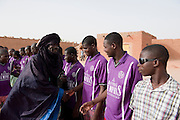 Mohamed aka Boss supporting his malien football team. All of the players are young african migrants from Mali. They all live in Boss' ghetto.