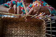 Phan Thi Nhanh spends her day weaving baskets made water hyacinth, an indiginous  and plentiful plant of the Mekong Delta region. The baskets are created for, and sold in shops run by the international NGO Vietnam Plus, which uses local resources to empower impoverished citizens. Hau Giang Province, Vietnam.