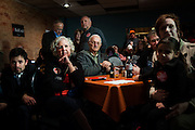 Supporters listen as Republican U.S. presidential candidate Ted Cruz does a live television interview ahead of his campaign stop at Prime Time Restaurant in Guthrie Center, Iowa on January 4, 2016. REUTERS/Mark Kauzlarich