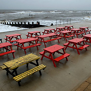 Southwold, Suffolk, Britain. Rain and heavy seas and empty cafe tables on Spring Bank Holiday Monday, 2008..COPYRIGHT PHOTOGRAPH BY BRIAN HARRIS  © 2008.07808-579804
