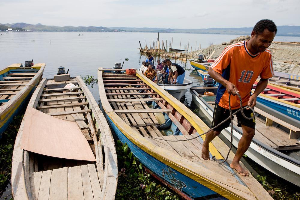 Boats at Sentani Lake, Papua, Indonesia, Sept. 7, 2008..Daniel Beltra/Greenpeace