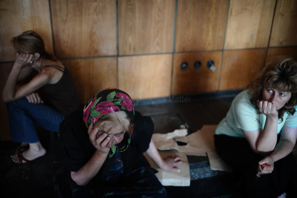 Women who fled their village after a Russian attack cry in the hall of the former Russian Ministry of Justice on August 29, 2008 in Tbilisi. Russia is facing an avalanche of criticism from the West over its decision to recognise the independence of two Georgian secessionist regions at the heart of the conflict: South Ossetia and Abkhazia.