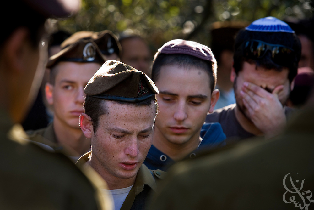 Israeli soldiers grieve as they take part in the funeral of Staff Sgt. Nitai Stern, 21,  at the Mt. Herzl cemetery in Jerusalem, Tuesday, Jan. 6, 2009. Stern and two other soldiers were killed Monday night when an Israeli tank shell mistakenly fired on their position in an apparent friendly-fire incident, Israeli sources said.