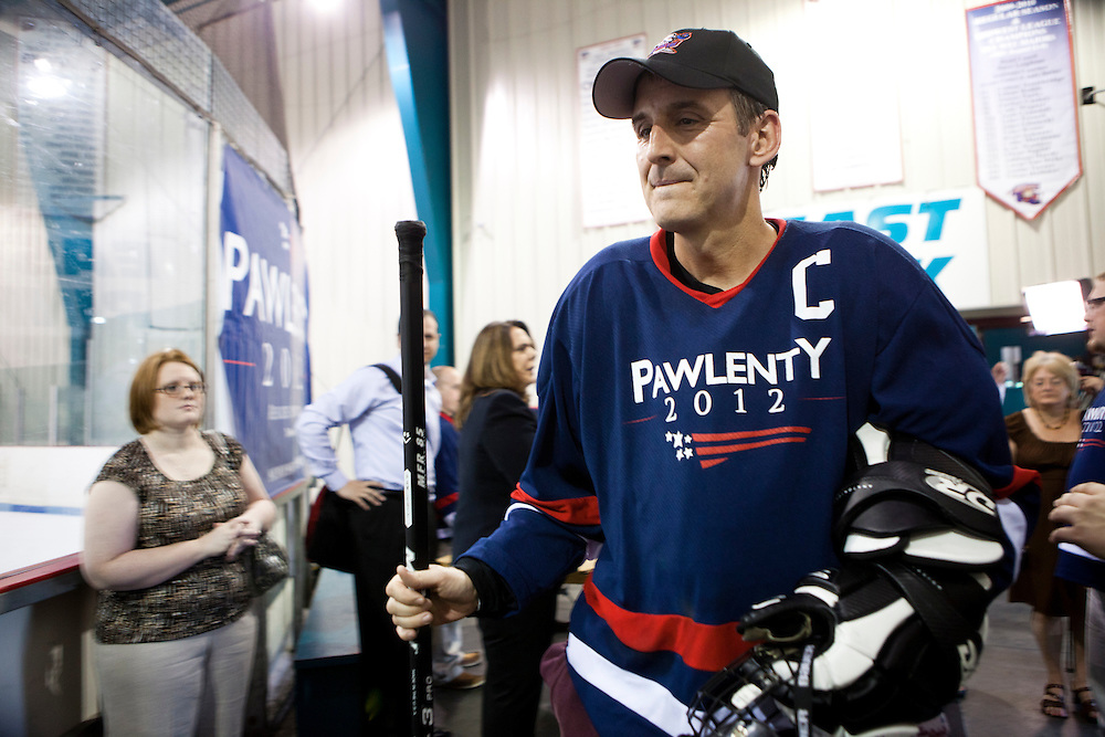 Republican presidential hopeful Tim Pawlenty walks to the locker room after playing in a scrimmage hockey game during a campaign stop on Friday, July 22, 2011 in Urbandale, IA.