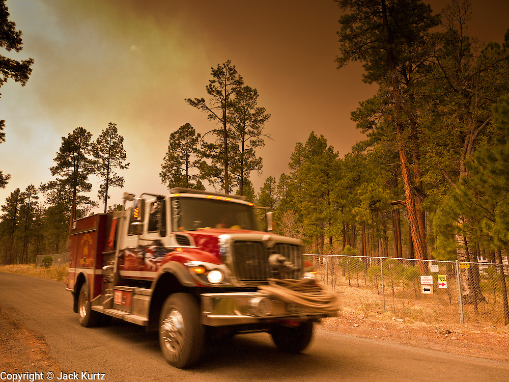 02 JUNE 2011 - ALPINE, AZ:  fire engine returns to the Incident Command Post at the Wallow Fire near Alpine. High winds and temperatures complicated firefighters' efforts to get the blaze under control. Officials have issued a preliminary evacuation order warning residents to be ready to move in the next 12 hours.   PHOTO BY JACK KURTZ