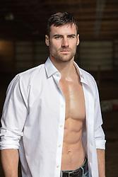 All American man in a white button down shirt All American rugged man in a white button down shirt