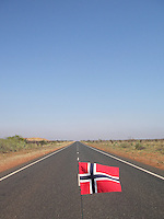 Highway and Norwegian flag in the wind