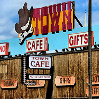 Town Cafe Marquee in Gardiner, Montana<br /> If you are leaving Wyoming through Yellowstone&rsquo;s North Entrance and need a family pit stop, then visit Gardiner, Montana. It has wooden, Wild West fa&ccedil;ades and marquees for its bars and shops. Many of the storefronts provide rocking chairs for watching passing cars or the mule deer, elk, bison and other wildlife meandering through this small frontier town of 850 people.