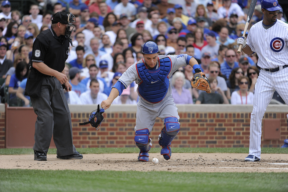 CHICAGO - MAY 30:  Catcher Russell Martin #55 of the Los Angeles Dodgers runs toward the ball then throws out Milton Bradley #21 of the Chicago Cubs when Bradley attempted to advance to second base on a ball that got away from Martin during the game on May 30, 2009 at Wrigley Field in Chicago, Illinois.  The Cubs defeated the Dodgers 7-0.  (Photo by Ron Vesely)