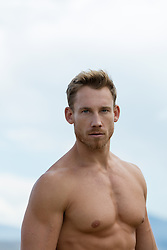 portrait of a hunky shirtless man outdoors