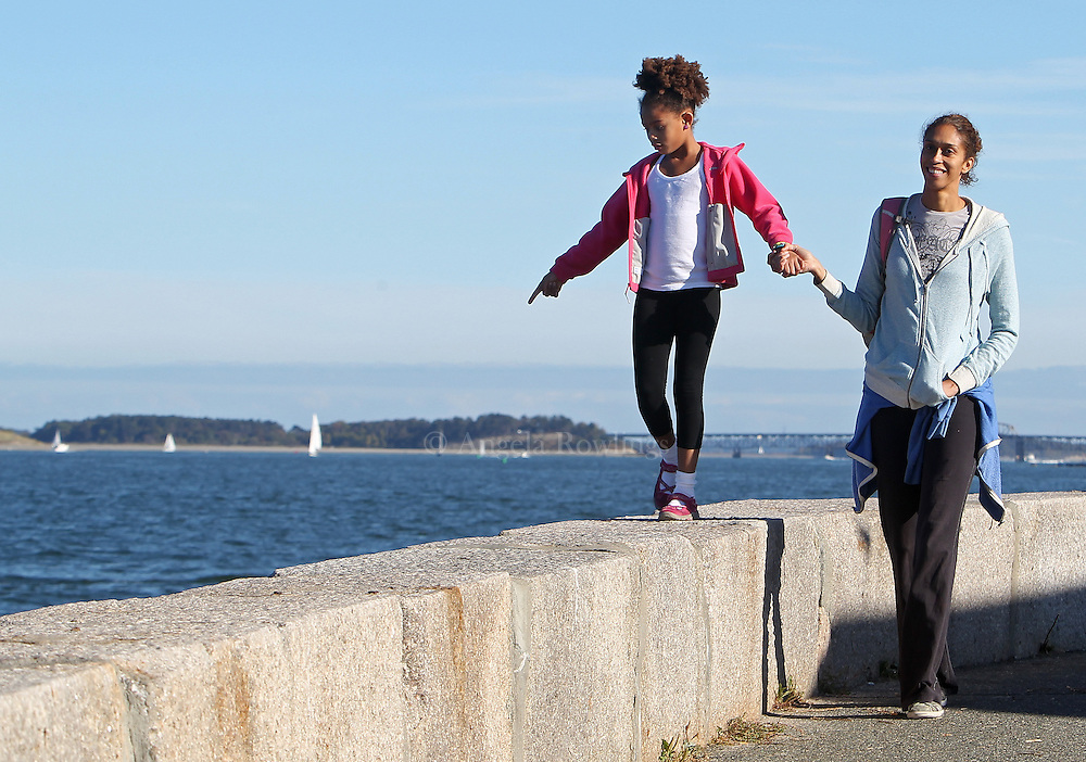 (Boston, MA - 9/29/13) Marianne Kotubetey and her daugher, Gabrielle, 7, of Winchester, walk along the water at the Sugar Bowl in South Boston, Sunday, September 29, 2013. Staff photo by Angela Rowlings.