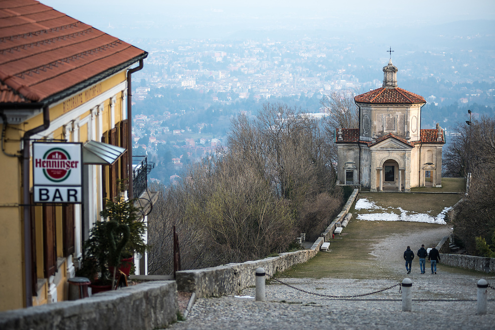 A cafe overlooks one of the chapels in Santa Maria Del Monte in Varese, Italy at sunset. Unesco, World Heritage Site.