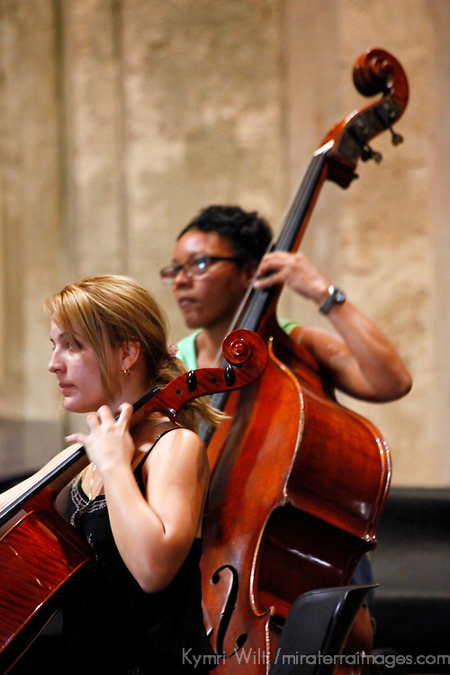 "Central America, Cuba, Havana. Cellists of Cuban Orchestra ""Camerata Romeu"" rehearses in Basilica Menor de San Francisco de Asis."