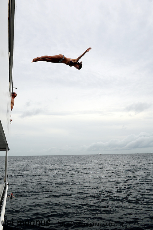 this photo win google photography prize , top 100.<br /> jump from the boat in the maldives island.