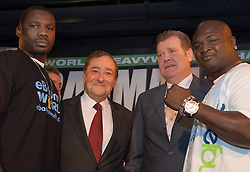 March 14, 2006 - New York, NY - (L to R) WBC Heavyweight Champion Hasim Rahman, Bob Arum, Dan Goossen, and challenger James Toney pose during the final press conference for their upcoming fight.  The two will face off on Saturday, March 18th at Boardwalk Hall in Atlantic City, NJ.