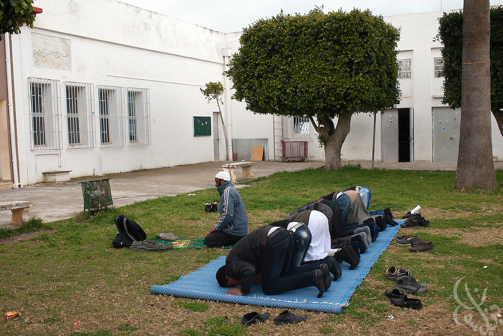 Tunisian Salafi leader Nadar Samali leads other Salafi students in prayer  during a class break on the grounds of the Manouba University March 05, 2012 on the outskirts of Tunis, Tunisia. Recently the university has been the scene of rowdy protests by Islamist students and Salafists who opposed the deans decision to ban Muslim women from wearing the niqab in classes.