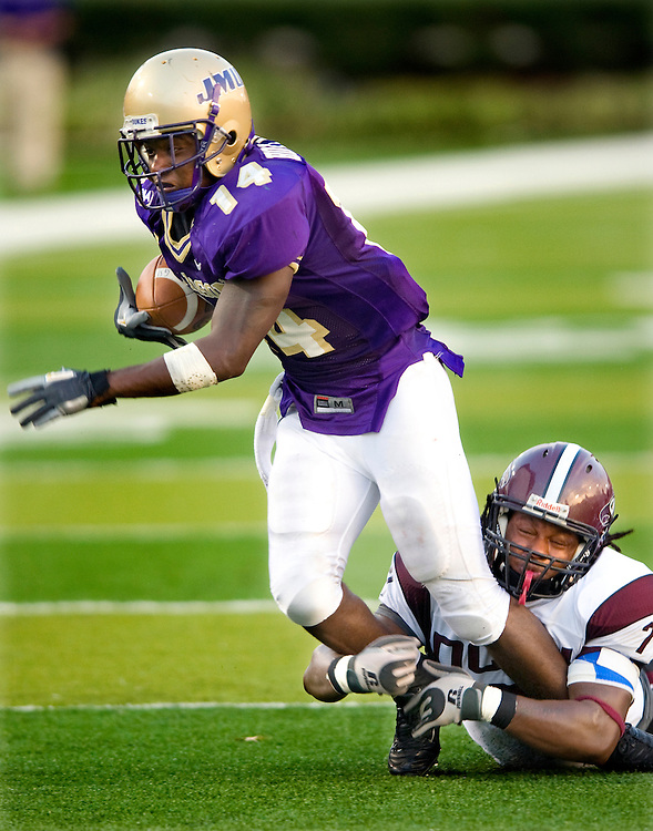 A North Carolina Central University player catches JMU's Eugene Holloman.