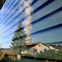 The cooling tower of the G&ouml;sgen Nuclear Power Plant (Kernkraftwerk G&ouml;sgen) reflected in window of a nearby house.  <br /> The Swiss are due to vote shortly in a referendum whether to quit nuclear power, which via its five reactors, on four sites, provide almost 40% of the country's power