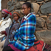 10 May 2011, Ha Tsekana Village, Semonkong Community Council, Maseru District, Lesotho. Agnes Lenake (Born 1945) is a local Village Assistance Committee Member who delivers Psycho-Social support services in is key in the roll-out of the Child Grant Programme in Lesotho. One of the families who receive the quarterly household grant of M 360, is the Ntoi Family:- Grandmother Masakiya Ntoi (72) supports two grandchildren, girl - Tebello Ntoi (15) and boy - Lehlohonolo Ntoi (11) .There are now more than 180,000 orphaned children in Lesotho and 58,8% or people live below the poverty line. The Child Grants programme is part of a larger package of child services that will help protect vulnerable children in Lesotho.