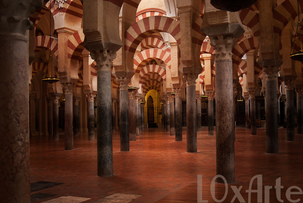 Arches and pillars of the Mezquita (former moorish mosque now cathedral) in Cordoba, Spain.