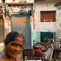 Santhome flat complex street fronts. Santhome Beach and adjoining Marina Beach in Chennai, India were hit hard by the 2004 Tsunami. Fishermen and their families were the main victims living in their lightweight huts on the long and flat beaches of the area. All structures within 300 metres of the sea have now been banned and any left standing after the Tsunami were demolished. The fishermen and their families have now been relocated to government blocks of flats which has become a Santhome slum for fishermen and their families.