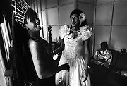 AIDS patients get ready to perform and put on a show for visitors at the Wat Prah Bat Nam Phu hospice, Lop Buri. The show is both to educate visitors and raise funds for the hospice.  September 2003.©David Dare Parker / AsiaWorks Photography